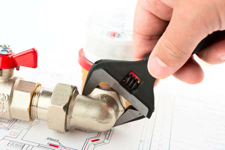 Men hands with spanner installing a counter