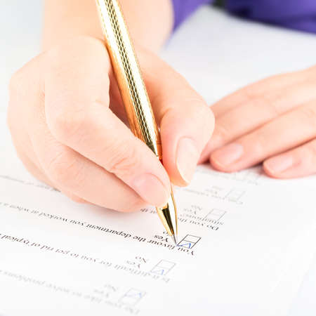 participant: Filling of questionnaire by a ball point pen Stock Photo