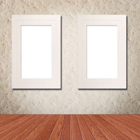 styled interior: White photo frame on grunge wall with clipping path