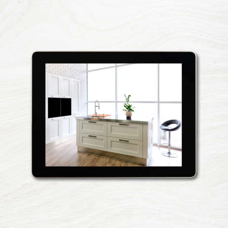 paper screens: digital tablet computer and interior image on screen