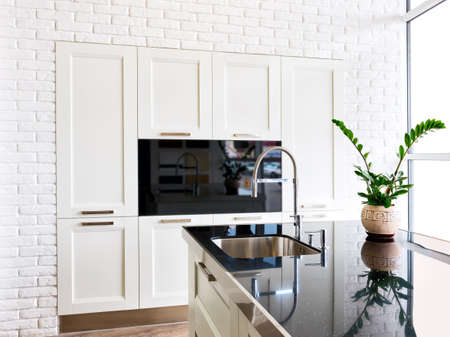 granite kitchen: white modern kitchen room in classical style Stock Photo