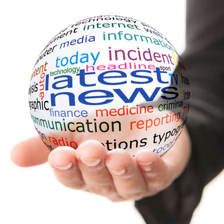 press news: Transparent ball with inscription latest news in a hand Stock Photo