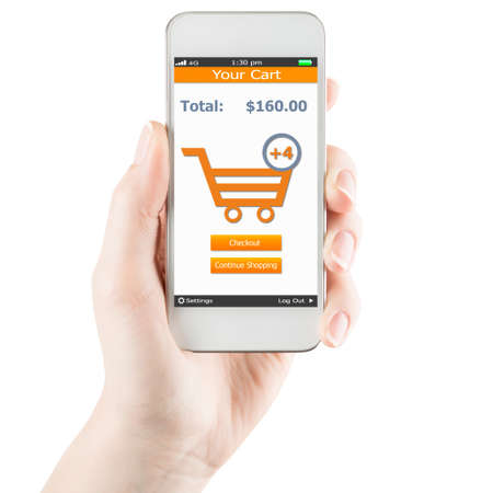 Hand holding smartphone with online shopping application on a screen