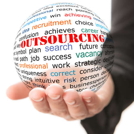 outsourcing: Hand take transparet ball with wordcloud and red inscription Outsourcing Stock Photo