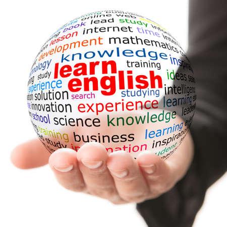 les geven: Transparante bal met inscriptie Engels te leren in een hand Stockfoto