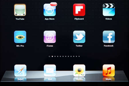 SIMFEROPOL, UKRAINE - OCTOBER 03, 2012: Icons of most popular applications on Apple iPad New display. Apple iPad New released in March 16, 2012.