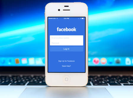 SIMFEROPOL, RUSSIA - NOVEMBER 01, 2014: Facebook Login page on black Apple iPhone screen. Facebook is largest and most popular social networking site in the world.