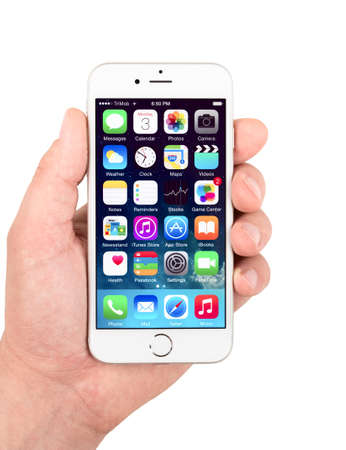 81: SIMFEROPOL, RUSSIA - NOVEMBER 03, 2014: Apple iPhone 6 silver displaying homescreen. The iPhone 6 and iPhone 6 Plus are smartphones running iOS developed by Apple Inc.