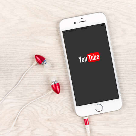 SIMFEROPOL, RUSSIA - NOVEMBER 03, 2014: Apple iPhone 6 plus displaying Youtube application. YouTube is the popular online video-sharing website, founded in February 14, 2005 Editorial