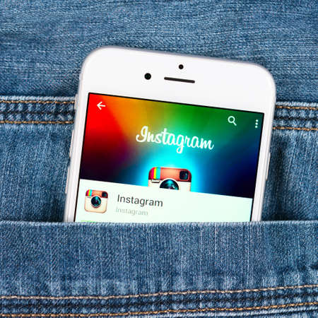 SIMFEROPOL, RUSSIA - NOVEMBER 11, 2014: Silver Apple iphone 6 in jeans pocket displaying Instagram application. Instagram is an online mobile photo-sharing, video-sharing and social networking service
