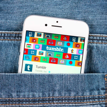 tumblr: SIMFEROPOL, RUSSIA - NOVEMBER 11, 2014: Silver Apple iphone 6 in jeans pocket displaying Tumblr application. Tumblr is a microblogging platform and social networking website