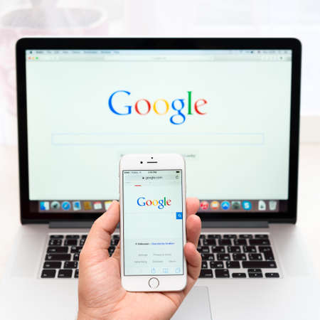 SIMFEROPOL, RUSSIA - NOVEMBER 16, 2014:  Google webpage Apple and iPhone 6 display. Google is an American multinational corporation specializing in Internet related services and products