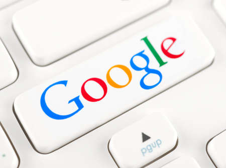 SIMFEROPOL, RUSSIA - NOVEMBER 22, 2014: Photo shoot of Google logotype on a keyboard button. Google is an American multinational corporation specializing in Internet-related services and products