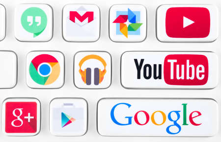 gmail: SIMFEROPOL, RUSSIA - NOVEMBER 22, 2014: Most popular logotypes of Google applications printed on sticker and placed on a buttons of keyboard. Included Youtube, Gmail, Chrome, Play market and other