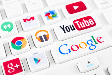 SIMFEROPOL, RUSSIA - NOVEMBER 22, 2014: Most popular logotypes of Google applications printed on sticker and placed on a buttons of keyboard. Included Youtube, Gmail, Chrome, Play market and other