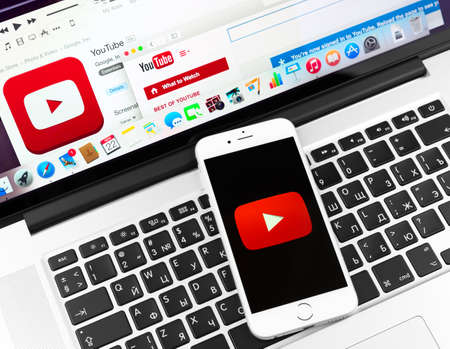 SIMFEROPOL, RUSSIA - NOVEMBER 22, 2014:  Youtube icon on Apple iPhone 6 and Macbook display. YouTube is the popular online video-sharing website, founded in February 14, 2005 Editorial
