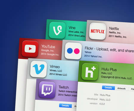 SIMFEROPOL, RUSSIA - NOVEMBER 27, 2014:  Popular applications for video hosting on computer display. Include: YouTube, Vimeo, Vine, Netflix, Flickr and other