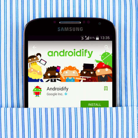 samsung galaxy: SIMFEROPOL, RUSSIA - April 18, 2015: Samsung Galaxy S4 in the pocket displaying Androidify application. Androidify - application for creating avatars based on Android logo.