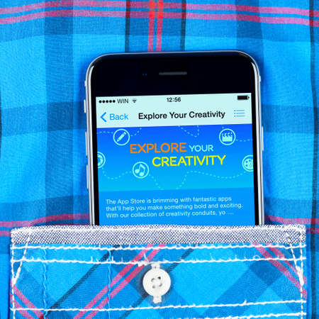 internet explorer: Simferopol, Russia - April 18, 2015: black Apple iPhone 6 in the pocket displaying explore your creativity inscription in the Apple store.