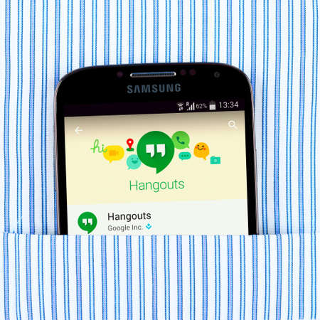 google: Simferopol, Russia - April 18, 2015: Photo of Hangouts application on the Samsung galaxy display. Google Hangouts is an instant messaging and video chat platform developed by Google Editorial