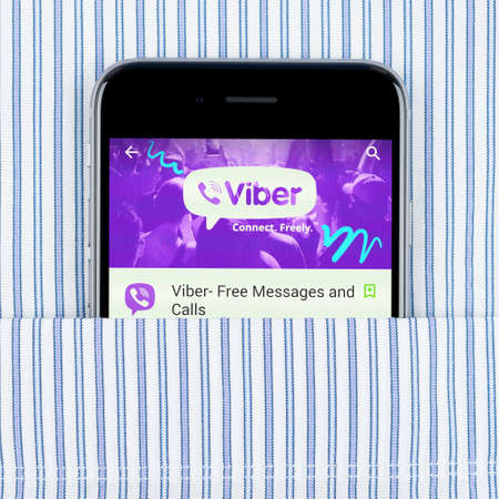 mobile voip: Simferopol, Russia - April 18, 2015: White Apple iPhone 6 in the pocket displaying Viber application. Viber is an instant messaging and Voice over IP VoIP app for smartphones developed by Viber Media