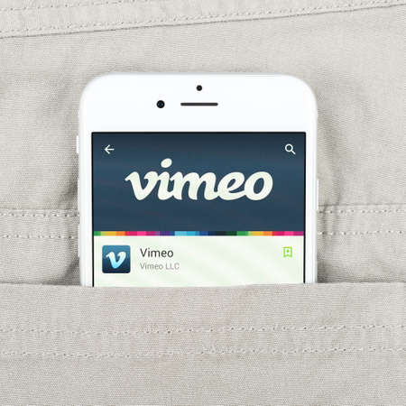 Simferopol, Russia - April 18, 2015: Black Apple iPhone 6 in the pocket displaying Vimeo application. Vimeo is a video-sharing website in which users can upload, share and view videos