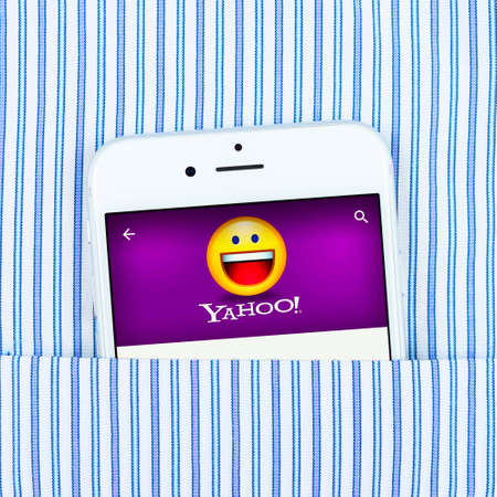 headquartered: Simferopol, Russia - April 18, 2015: White Apple iPhone 6 in the pocket displaying Yahoo application. Yahoo Inc. is an American multinational Internet corporation headquartered in California Editorial