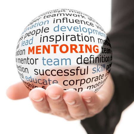Concept of mentoring. Transparent ball with inscription mentoring in a hand Foto de archivo
