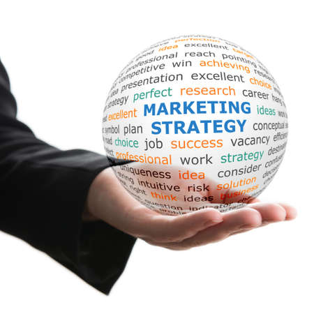 business marketing: Concept of Marketing strategy in business. Words on the transparent ball in the hand