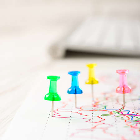 selective focus: Close up of pin on graph data. Finance concept. Stock Photo