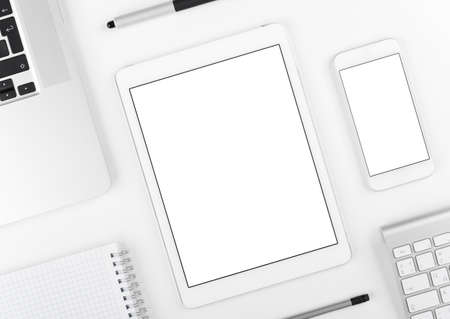 Top view: Laptop tablet and smartphone on white table background with text space and copy space.