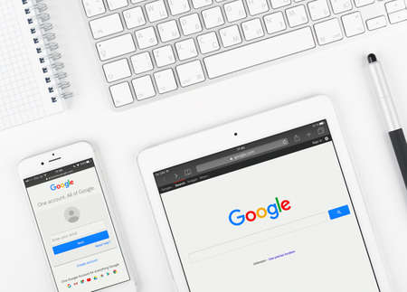 google: Moscow, Russia - March 12, 2016:  Google web page on display of iPad and iPhone. Google is an American multinational corporation specializing in Internet related services and products