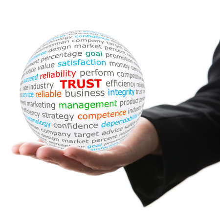 liable: Trust concept. Hand take white ball with trust word in red color. Stock Photo