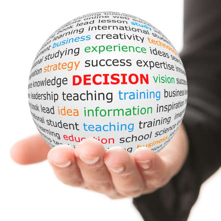 assumption: Decision concept. Hand take white sphere with red inscription decision . Stock Photo
