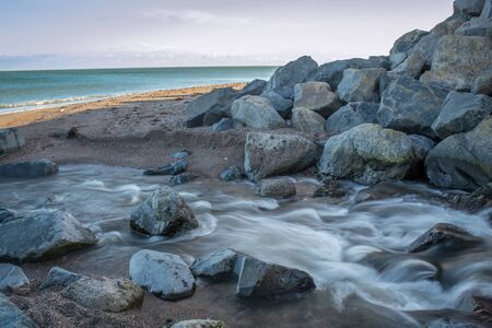 River Coming to the Sea at Greystones Beach Stock fotó