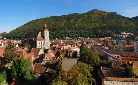 romanian: Center of the old town of Brasov City (Transilvania, Romania). In background you can see Tampa mountain (955 m)