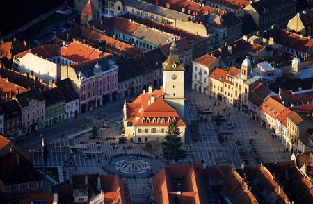 barsa: Center of the old town of Brasov City (Transilvania, Romania). The Council Square (Piata Sfatului) is the heart of the old medieval Brasov. Lined with beautiful red-roofed merchant houses, the square is one of the finest in the country. In the center of t