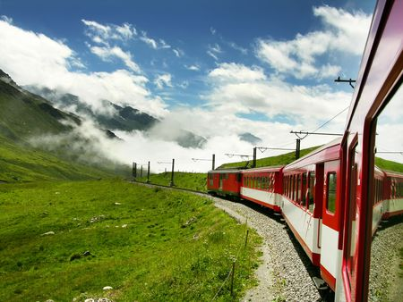 Swiss train from Oberalppass to Andermatt, in Switzerland mountains.          Stock Photo