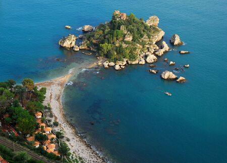 Isola Bella is a small island near Taormina, Sicily, southern Italy. Also known as The Pearl of the Ionian Sea it was a private property until 1990, when it was bought by the state and transormed into a nature reserve, administrated by the Italian branch