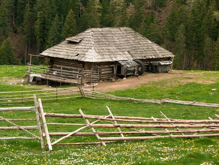 Shepherd cottage in Romania mountains photo