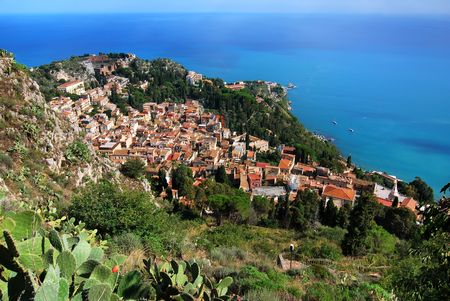 Taormina city view from Saracen castle.  Taormina is a small town on the east coast of the island of Sicily, Italy. Taormina is a very popular tourist destination since the 19th century. Stock Photo