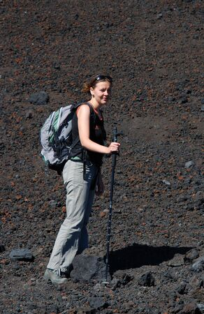 crater highlands: Trekking on Etna mountain (3323 m altitude) in Sicily. The asscension to the top is dangerous by the altitude, thunders, sulphuric emanation and the posibility of volcano eruption.