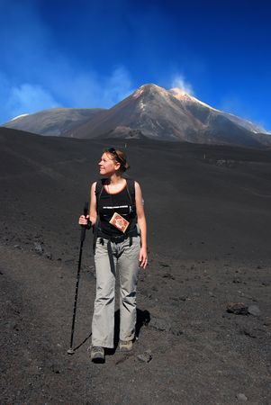 emanation: Trekking on Etna mountain (3323 m altitude) in Sicily. The asscension to the top is dangerous by the altitude, thunders, sulphuric emanation and the posibility of volcano eruption.