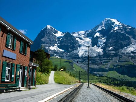 monch: Railway station of Wengernalp with Eiger mountain (3970 m) and Monch (4107 m), two famous peaks from Swiss Alps. Stock Photo