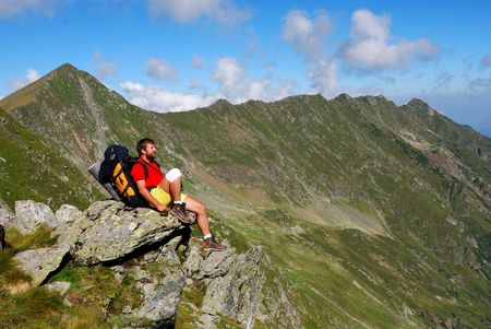 sighting: Tourist sighting the mountain landscape in Carpathian trails Stock Photo