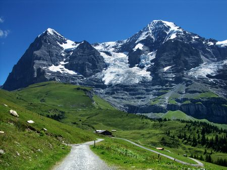 eiger: Panorama with Eiger mountain (3970 m) and Monch (4107 m) mountain, Switzerland Alps.