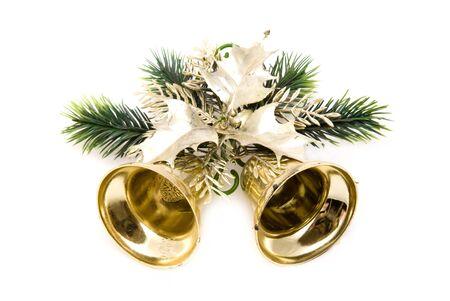 Christmas golden bell on white background photo