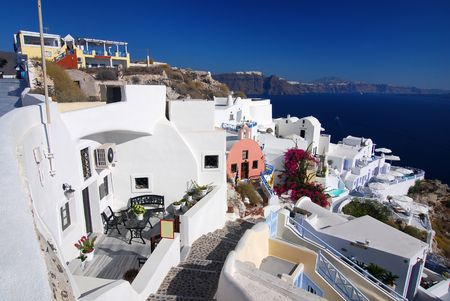 Oia is a community on the islands of Thira (Santorini) and Therasia, in the Cyclades, Greece. photo