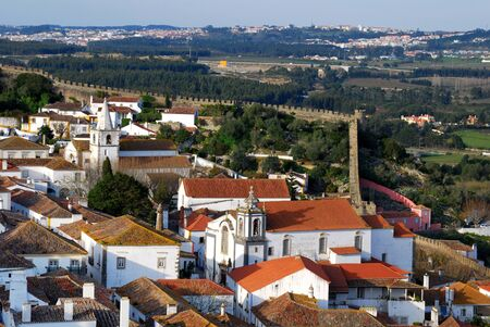fortified wall: The town of Obidos is located on a hill and is still encircled by a fortified wall, Portugal.