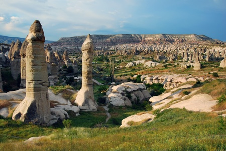 honeycombed: Cappadocia landscape panorama with vulcanic rocks and houses carved in this rock. (Goreme village)